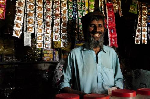 An older man in his shop in Bangladesh