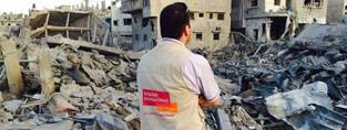 HelpAge staff in the rubble in Gaza (c) HelpAge International
