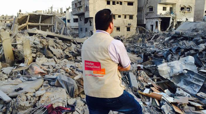 HelpAge staff member surrounded by rubble in Gaza