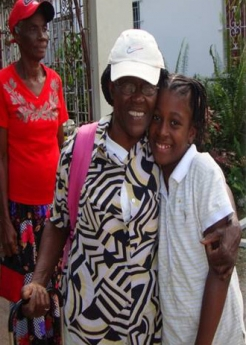 An older women in Jamaica shares a special moment with her granddaughter.