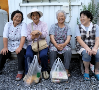 Older Japanese women smiling
