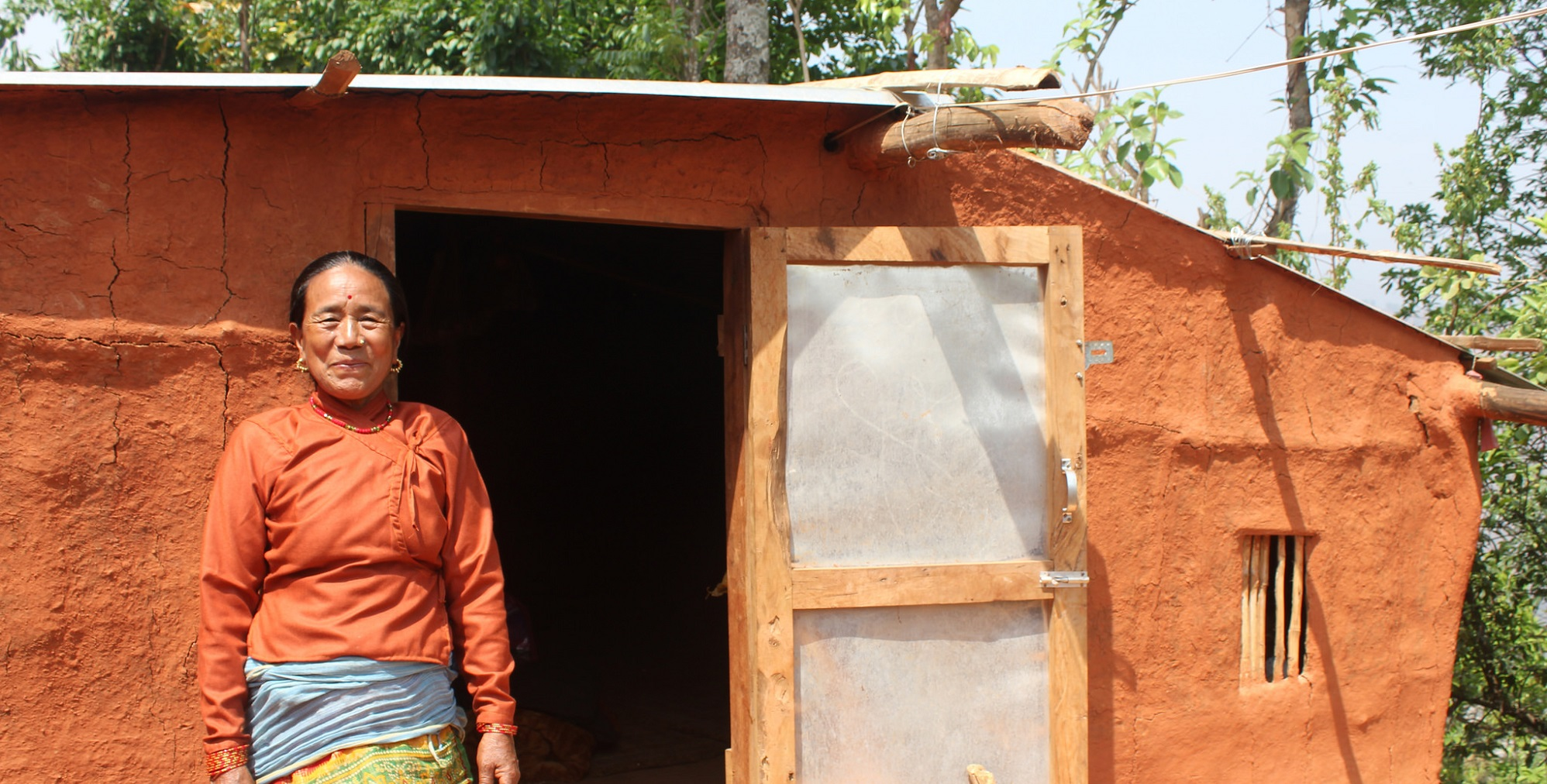 Kanchi's house collapsed in the earthquake, we helped her with materials for a temporary shelter (c) Judith Escribano/Age International