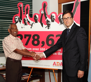 Handing over the petition. (c) Anton Brookes/HelpAge International