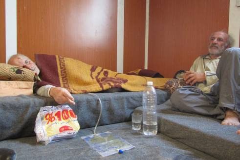 Mahbud, 69 and his son Hisham, 52 arrived in Zaatari camp two weeks ago. Mahbud is partially paralysed and cannot chew the food provided in the camp.