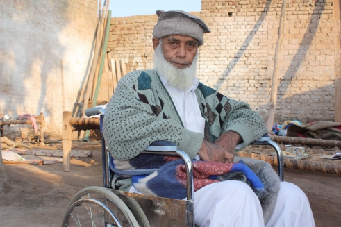 Hashim, 73, from Nowshera in a HelpAge wheelchair