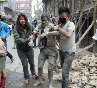 People free a man from the rubble of a destroyed building following a massive earthquake that struck Nepal early on Saturday. (c) Narendra Shrestha/EPA