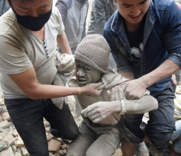 Rescuers free a man from the rubble. Credit: EPA / NARENDRA SHRESTHA