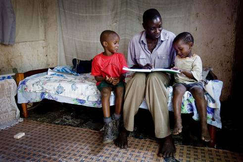 Simon reads to his grandchildren.