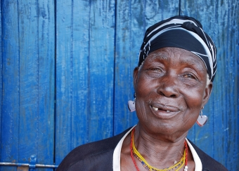 Nziku left her village after she received threatening letters. Her community brought her back and built her a new house.