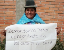 Bolivian campaigner holds a sign: 'We demand better treatment for older people at health centres'