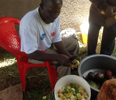 Older man in Tanzania learning how to safely prepare healthy food. (c) Jamillah Mwanjisi/HelpAge International