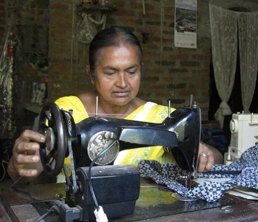 Piyaseeli joined an older people's association, which helped her to buy a better sewing machine.