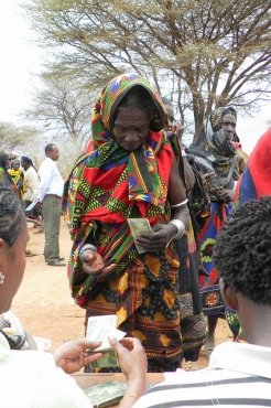 Seke Wako Arero, 70, collects her cash transfer
