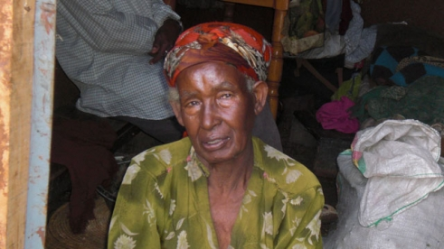 Tewabech, 70, struggles to survive and provide for her three grandchildren.