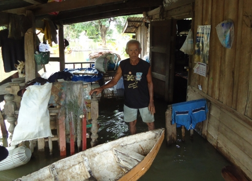 An older man in his flooded home in Thailand