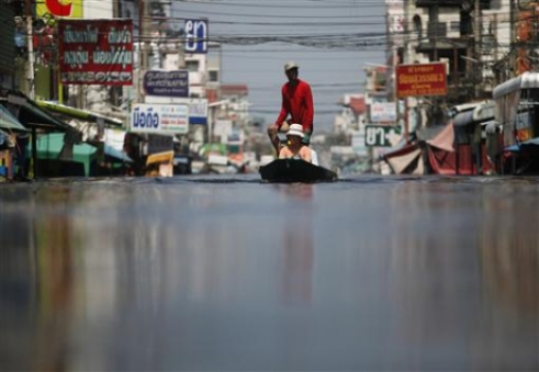 Residents flee the floods in Bangkok