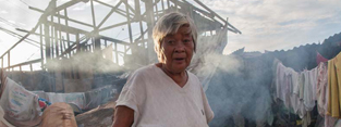 An older woman in the Philippines, scenes of devastation from Typhoon Haiyan.