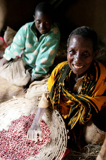 An older Tanzanian woman and her granddaughter. Photo: Kate Holt/HelpAge International.