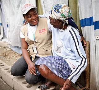 An older woman and community nurse in Haiti after the earthquake. (c) Frederic Dupoux/HelpAge International