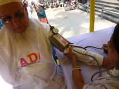 An older man has his blood pressure taken in Bangladesh.